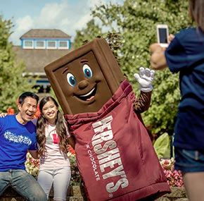 A family photo with the Hershey bar character