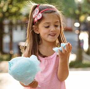 Girl eating cotton candy at Hersheypark