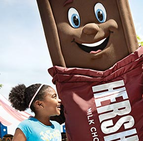 The Hershey bar character with a girl at Hersheypark
